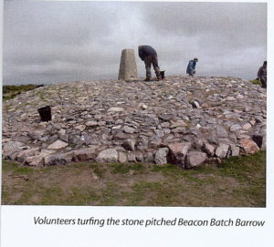 Volunteers turfing the newly stone-pitched Beacon Batch Barrow.